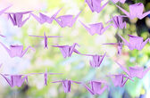 Origami cranes on nature background — Stock Photo