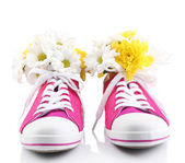 Beautiful gumshoes with flowers inside, isolated on white — Stok fotoğraf