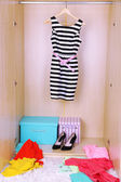 Dress with hangers in wardrobe — 图库照片