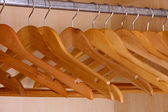 Wooden hangers in wardrobe — Photo