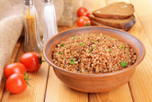 Boiled buckwheat in bowl on table close-up — Stock Photo