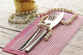 Table place setting with decorations on color wooden background — Stock Photo