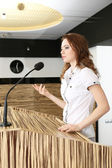 Businesswoman is making speech at conference room — Stok fotoğraf