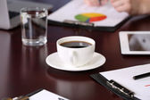 Cup of coffee on table close-up — Stok fotoğraf