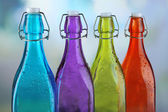 Colorful bottles on light background — Stock Photo