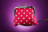 Glamour purse in silver spoon on purple background — Stok fotoğraf