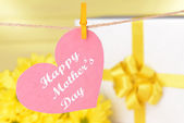 Happy Mothers Day message written on paper heart with flowers on yellow background — Foto Stock