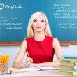Young teacher sitting in school classroom — Stock Photo #43663005