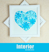 Beautiful handmade picture with heart from paper flowers on wall — Foto de Stock