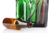 Glass bottles in recycling bin close up — Stock Photo