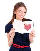 Jolie femme avec carte postale, isolé sur blanc — Photo