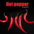 Red hot chili peppers on black background — Stock Photo #43720733