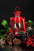 Red kerosene lamp on black background — Stock Photo