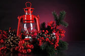 Red kerosene lamp on dark color background — 图库照片