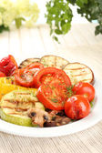 Delicious grilled vegetables on plate on table close-up — Stock Photo