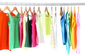 Different clothes on hangers, on gray background — Foto de Stock