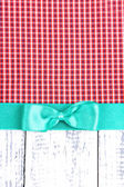 Colorful fabric with color ribbon and bow on wooden background — Stock Photo
