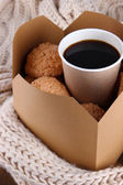 Hot coffee and cookies in box on knitted scarf  close-up — Stock Photo