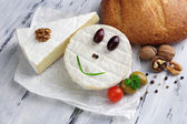 Tasty Italian cheese and bread on wooden table — Stock Photo