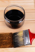 Applying protective varnish to wooden board close-up — ストック写真
