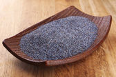 Poppy seeds in bowl on table close-up — Stock Photo