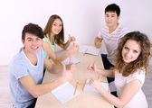 Group of young students sitting in room — ストック写真