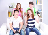 Group of young friends playing video games at home — 图库照片