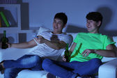 Two friends watching football at home of blacking-out — ストック写真