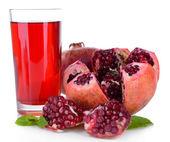 Ripe pomegranates with juice isolated on white — Stock Photo