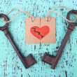Keys to love, Conceptual photo. On color wooden background — Stock Photo #43864473