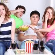 Group of young friends watching television at home — Stock Photo #43865795
