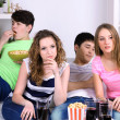 Group of young friends watching television at home — Stock Photo #43865799