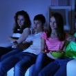 Group of young friends watching television at home of blacking-out — Stock Photo