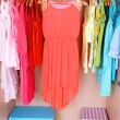 Colorful clothes hanging in wardrobe — Stock Photo #43868753