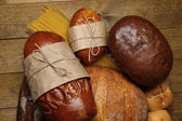 Bakery products on wooden table — Stock Photo