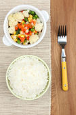 Cooked rice with vegetables on wooden table  — Foto Stock