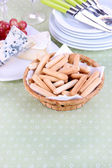 Composition with cheese, grape and bread sticks on plate on table, on  sackcloth background — Stock Photo