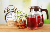 Tasty herbal tea and cookies on wooden table — Stock Photo