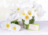 Beautiful bouquet of white tulips on table on light background — Stock Photo