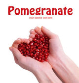 Ripe pomegranate in hands isolated on white — Stock Photo