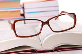 Composition with glasses and books, isolated on white — Stock Photo