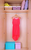 Dress with hangers in wardrobe — Stock Photo