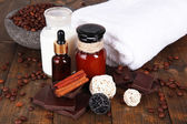 Beautiful chocolate spa setting on wooden table close-up — Stock Photo