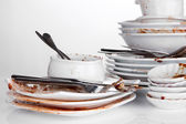Dirty dishes isolated on white — Stock Photo