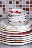 Dirty dishes on bright background — Stock Photo