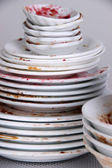 Dirty dishes on gray background — Stock Photo