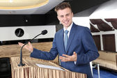 Businessman is making speech at conference room — Stock Photo