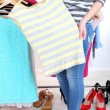 Young woman choose clothes near rack with hangers — Stock Photo #43871223