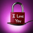 Love padlock in silver spoon on purple background — Stock Photo