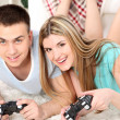 Couple playing video games on home interior background — Stock Photo #43878961